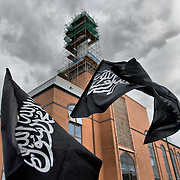 LONDON, ENGLAND - SEPTEMBER 11: Muslims gather outside Harrow central mosque ahead of today's expected rival protests on September 11, 2009 in London, England. Anti-fascist demonstrators and local Muslim youths have gathered to counter a threatened march by anti-Islamic right wing groups. (Photo by Marco Secchi/Getty Images)