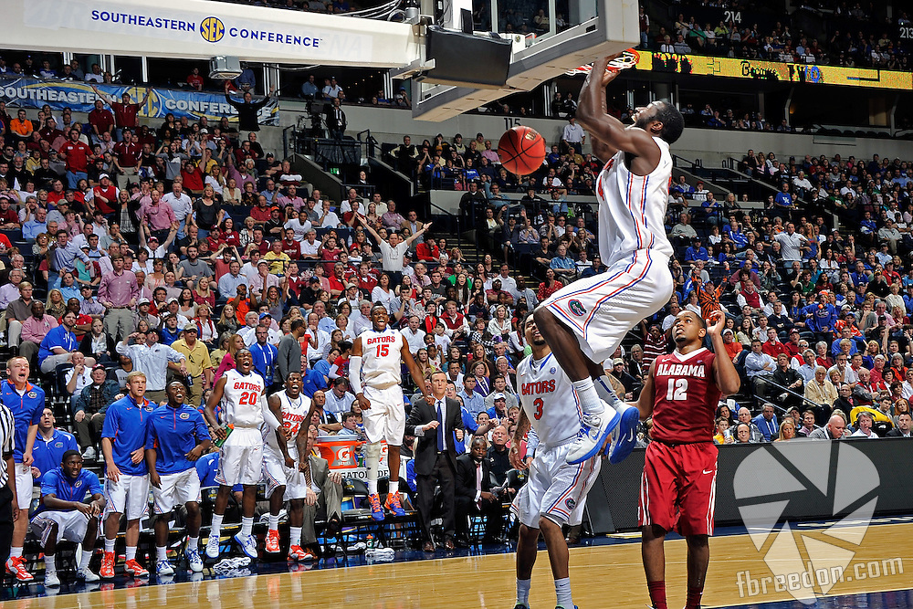 NASHVILLE, TN - MARCH 16:  Patric Young #4 of the Florida Gators dunks against the Alabama Crimson Tide  during the Semifinals of the SEC Basketball Tournament at the Bridgestone Arena on March 16, 2013 in Nashville, Tennessee.  (Photo by Frederick Breedon/Getty Images)