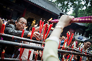 Chinese pilgrims burn candles and incense in the temple of The Giant Buddha (Chinese: 樂山大佛 ; Lèshān Dàfó) in Leshan, China, August 09, 2014.<br /> <br /> Confucianism, Taoism and Buddhism are the three major religions in China. Temples and statues witness their ancient roots all over the Chinese country.<br /> <br /> © Giorgio Perottino