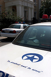 30 Sept, 2005.  New Orleans, Louisiana.  Hurricane Katrina aftermath. <br /> 'To protect and serve.' The logo on the back of a  New Orleans Police Department vehicle parked outside the French Quarter police HQ.<br /> Photo; ©Charlie Varley/varleypix.com