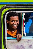 People looking out a bus window, Debre Markos, Ethiopia.