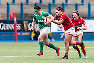 Lindsay Peat of Ireland keeps running despite being held firmly by Amy Evans of Wales.<br /> RBS Womens Six Nations 2017 international rugby, Wales women v Ireland women at the BT Sport Cardiff Arms Park in Cardiff , South Wales on Saturday 11th March 2017.  pic by Simon Latham, Andrew Orchard sports photography