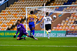 Jordan Graham of Mansfield Town chips Kelle Roos of Derby County to open the scoring against Derby County - Mandatory by-line: Ryan Crockett/JMP - 18/07/2018 - FOOTBALL - One Call Stadium - Mansfield, England - Mansfield Town v Derby County - Pre-season friendly