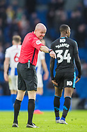Lee Mason (Referee) pointing out a area of the pitch as Rekeen Harper (West Brom) walks on by during the FA Cup fourth round match between Brighton and Hove Albion and West Bromwich Albion at the American Express Community Stadium, Brighton and Hove, England on 26 January 2019.