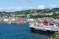 View of town of Oban with Caledonian Macbrayne ferry in Argyll and Bute, Scotland, United Kingdom
