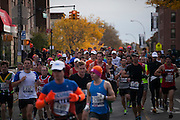 Participants approach 4th Ave on 92nd St in the New York City Marathon on 4th Ave in Brooklyn, NY on Sunday, Nov. 3, 2013.<br /> <br /> CREDIT: Andrew Hinderaker for The Wall Street Journal<br /> SLUG: NYSTANDALONE