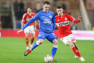Peterborough United midfielder Callum Cooke (14) plays the ball under pressure from Middlesbrough forward Stephen Walker (46) during the The FA Cup 3rd round match between Middlesbrough and Peterborough United at the Riverside Stadium, Middlesbrough, England on 5 January 2019.