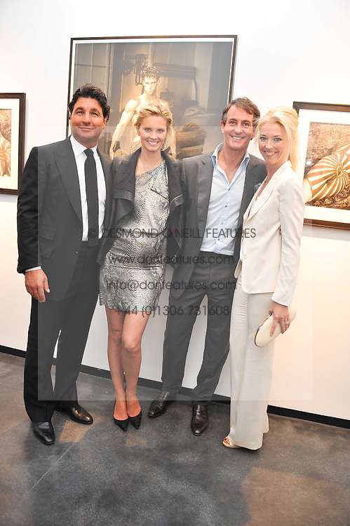 Left to right, GEORGIO VERONI, MALIN JEFFERIES, TIM JEFFERIES and TAMARA BECKWITH at a private view of photographs by Herb Ritts held at Hamiltons Gallery, 13 Carlos Place, London on 21st June 2011.