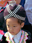 Girl age 4 dressed in ethnic clothing. In the Heart of the Beast May Day Festival and Parade Minneapolis  Minnesota USA