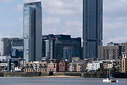 Thames riverside residential properties and London Docklands Cityscape, on 11th August 2021, in London, England.
