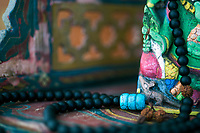 Mala detail of Ganesha spiritual altar. Malas are powerful tools for meditation. The mala is an essential tool for counter mantra recitals. This traditional mythological elephant is known as the remover of obstacles and his divine power can be invoked during times of adversity.