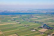Nederland, Utrecht, Gemeente Eemnes, 06-09-2010; polders tussen Eemnes en Spakenburg gezien naar Flevoland. Een van de laatste open polderlandschappen in de Randstad. Het riviertje de Eem mondt uit in het Eemmeer.  De polders zijn: Zuidpolder te Veld, Noordpolder te Veld, Maatpolder Bikkerspolder..Polders between Eemnes and Spakenburg seen to Flevoland. One of the last open polder landscapes in the Randstad. The river Eem flows into the Eemmeer. .luchtfoto (toeslag), aerial photo (additional fee required).foto/photo Siebe Swart