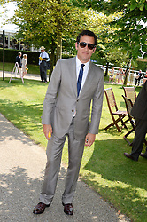 CLIVE OWEN at the 3rd day of the 2013 Glorious Goodwood racing festival - Ladies day at Goodwood Racecourse, West Sussex on 1st August 2013.