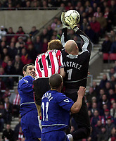 Photo. Richard Lane. <br />Southampton v Manchester United. Barclaycard Premiership. 01/02/2003<br />James Beatie puts in the challenge that caused Fabien Barthez to be carried off.