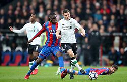 Crystal Palace's Christian Benteke (left) and Liverpool's James Milner battle for the ball during the Premier League match at Selhurst Park, London.