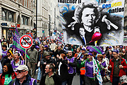 Margaret Thatcher banner. Peaceful demonstration along Piccadilly in central London by protesters during the TUC union march against cuts, Saturday March 26th 2011. Around 400,000 people joined the TUC's March for the Alternative to oppose the coalition government's spending cuts. Teachers, nurses, midwives, NHS, council and other public sector workers were joined by students and pensioners to bring the centre of the capital to a standstill and to make their point that the current coalition government is making cuts too fast which they suggest will have a catastrophic effect on jobs and economic recovery.