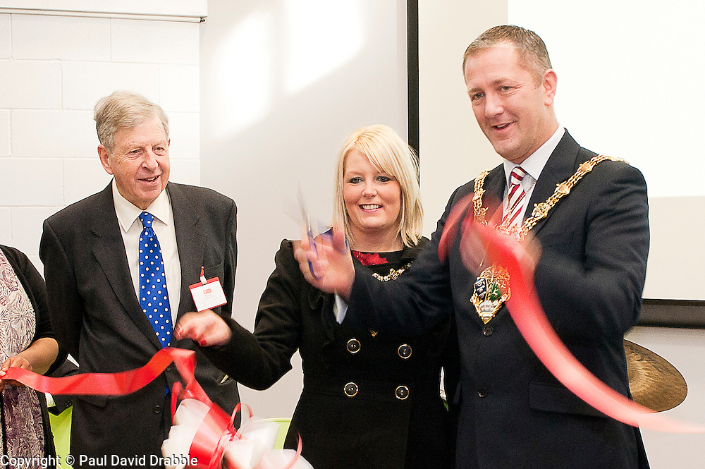 """Dr Peter Lee the President of the WHite Rose YMCA with  Mayor and Mayoress of Rotherham Cllr Shaun Wright JP and  Mrs Lisa Wright cut the ribon and officially open """"My Place"""" on St Annes Roundabout Rotherham Saturday Lunchtime.114619-2.26 November 2011  Image © Paul David Drabble"""