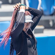 TOKYO, JAPAN - JULY 23: Naomi Osaka of Japan adjust her hair while practicing on court one at Ariake Tennis Park in preparation for the Tokyo 2020 Olympic Games on July 223 2021 in Tokyo, Japan. (Photo by Tim Clayton/Corbis via Getty Images)