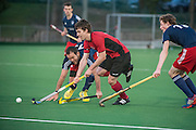 Timmy Smyth of Southgate drives through the Oxted defence. Southgate v Oxted, Trent Park, Southgate, UK on 08 March 2014. Photo: Simon Parker