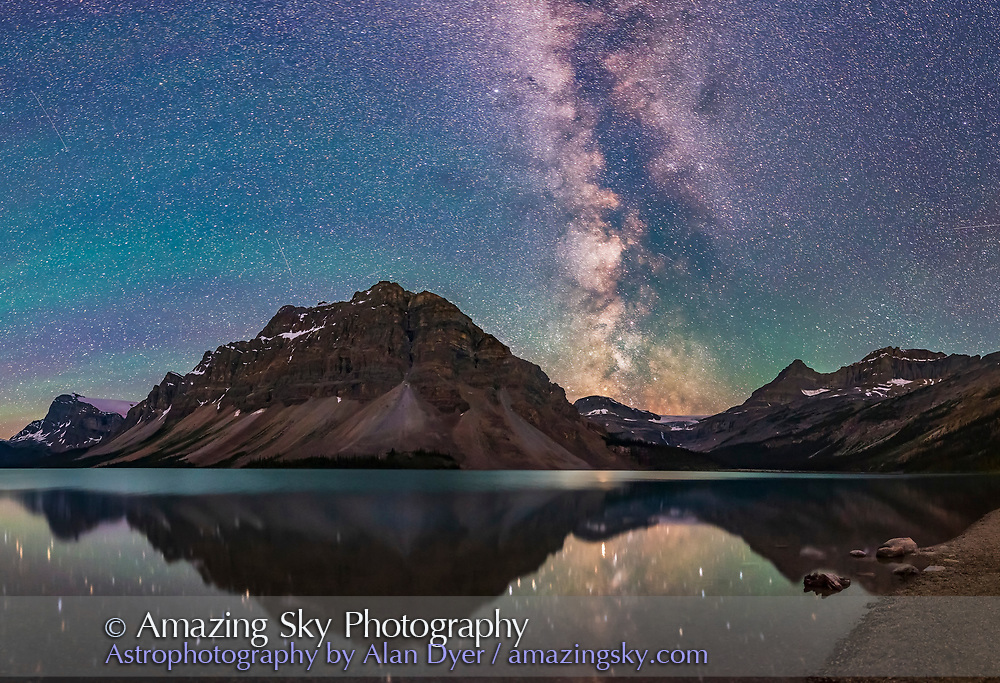A panorama of Bow Lake in Banff National Park, Alberta on a very dark and clear night, July 17, 2018. The Milky Way toward the galactic core lies above Bow Glacier. Saturn is reflected in the still waters. <br /> <br /> Bands of green airglow colour the sky to the south at left.<br /> <br /> I shot this about 2:45 am July 17, 2018. This is a crop of a full 360° panorama consisting of three tiers of 7 segments each, with the 20mm Sigma Art lens at f/2 and Nikon D750 at ISO 6400 for 30 seconds for each segment. <br /> <br /> I used the Syrp Genie Mini for the automatic camera positioning in azimuth. I stitched the panorama with PTGui.
