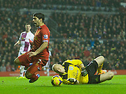 18.01.2014  Liverpool, England.   Liverpool's Luis Suarez is  brought down by Villa keeper Brad Guzan and is given a penalty during the Premier League game between Liverpool and Aston Villa. From Anfield Stadium.