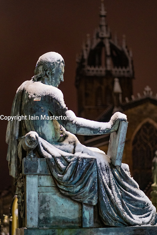 Edinburgh, Scotland, UK. 21 January 2020. Scenes taken between 4am and 5am in Edinburgh city centre after overnight snow fall. Pic; Statue of David Hume covered in snow in the Old Town. Iain Masterton/Alamy Live News