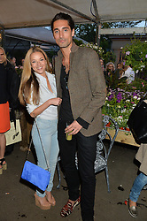 HUGO TAYLOR and NATALIE JOEL at a party to celebrate the launch of the Taylor Morris Eyewear's Summer Collection held at The Chelsea Gardner, 125 Sydney Street, London on 20th May 2015.