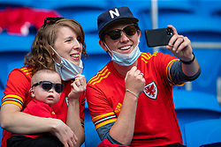 CARDIFF, WALES - Saturday, June 5, 2021: Wales supporters with a baby during an International Friendly between Wales and Albania at the Cardiff City Stadium in their game before the UEFA Euro 2020 tournament. (Pic by David Rawcliffe/Propaganda)