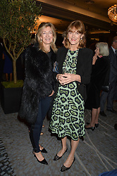 Left to right, LAURA WEINSTOCK and VIRGINIA JOHNSON at a party to celebrate the publication of Thenford: The Creation of an English Garden by Michael & Anne Heseltine held at The Grosvenor House Hotel, Park Lane, London on 24th October 2016.