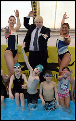 Mayor Boris Johnson with Team GB synchronised swimming stars  Katie Dawkins and (left) Jazmine Stansbury (right) , who dropped in to check out the pool in action at Maria Fidelis School in Camden as part of the Mayors 'Make a Splash initiative, London<br /> Thursday, 30th May 2013<br /> Picture by Andrew Parsons / i-Images