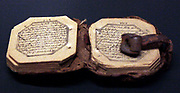 Miniature Qur'an, dated 1309 H/AD 1889-90, Iran, Arabic using ghubar script on paper.  Miniature copies of the Qur'an may be carried by pilgrims.