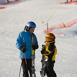 A brother and sister at the bottom of the Quechee Ski Hill in Quechee, Vermont. Model Release.