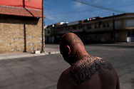 """Hector Barajas-Varela, a deported U.S. Army veteran, stands outside the Deported Veterans Support House in Tijuana, Baja California, México, Friday, July 7, 2017. His back tattoo reads, """"U.S. Banished Veteran.""""<br /> <br /> Barajas-Varela was born in México and arrived to the United States at a young age becoming a legal permanent resident shortly after. In 1996, he enlisted in the Army as a green card holder at age 17. He served six years split with the 82nd Airborne and a medical unit in MOS Patient Administration before being honorably discharged in 2001."""