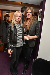 Left to right, SCARLETT CARLOS CLARKE and LEVI YOUNG at a private view of photographs 'Terry O'Neill-The Best Of' held at The Little Black Gallery, 13A Park Walk, London on 16th January 2014.