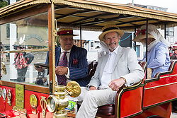 Datchet, UK. 30 June, 2019. The occupants of a 1904 De Dion Bouton, which arrived first on the 48-mile Ellis Journey from Micheldever station near Winchester to Datchet, a reenactment of the first recorded journey by a motorised carriage in England undertaken by pioneer automobilist Hon. Evelyn Ellis in his new, custom-built Panhard-Levassor on 5th July 1895.