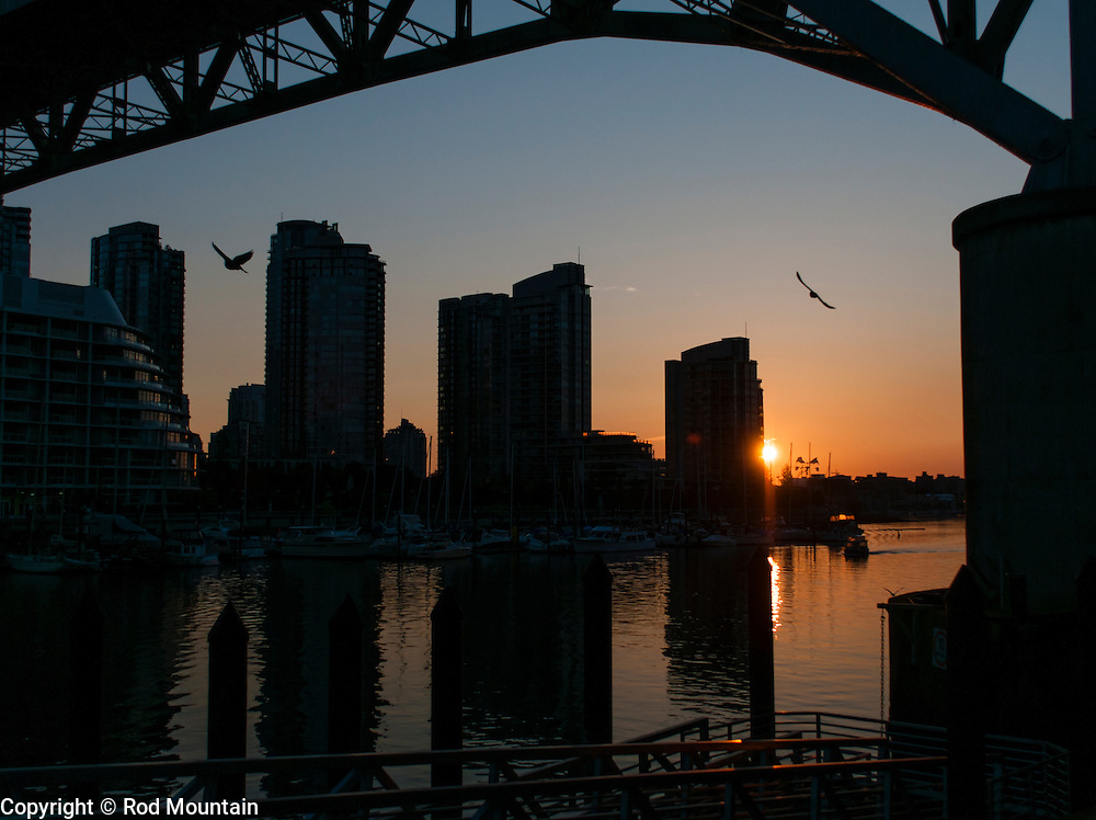 A cityscape silhouette as seen at dawn along False Creek, Vancouver, British Columbia