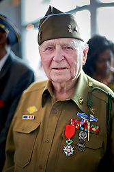 06 June 2014. The National WWII Museum, New Orleans, Lousiana. <br /> WWII veteran Pfc Horace Calhoun, Company K, 116th Infantry, 3rd Battalion is presented with the French Legion of Honor medal. <br /> Photo; Charlie Varley/varleypix.com