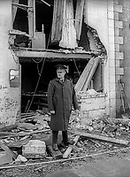 Policeman on duty outside the Imperial Bar, Stewartstown, Co Tyrone, N Ireland, UK, following the previous day's no warning bomb attack on 3rd February 1972 in which one man died. The victim, Louis O'Neill, 49 years, Roman Catholic, married with six children, was drinking in the Roman Catholic-owned bar which was ostensibly closed, along with other bars, out of respect for Bloody Sunday victims. There was speculation that the bombing was carried out by the IRA because the bar had not closed completely. However the bombing fitted the pattern of loyalist attacks in and around Co Tyrone at the time. 197203040094<br /> <br /> Copyright Image from Victor Patterson, 54 Dorchester Park, Belfast, UK, BT9 6RJ<br /> <br /> t1: +44 28 9066 1296 (from Rep of Ireland 048 9066 1296)<br /> t2: +44 28 9002 2446 (from Rep of Ireland 048 9002 2446)<br /> m: +44 7802 353836<br /> <br /> victorpatterson@me.com<br /> victorpattersonbelfast@gmail.com<br /> <br /> www.victorpatterson.com<br /> <br /> Please see my Terms and Conditions of Use at victorpatterson.com . It is IMPORTANT that you familiarise yourself with them.<br /> <br /> Images used on the Internet incur an additional cost and must be visibly watermarked i.e. ©Victor Patterson within the body of the image and copyright metadata must not be deleted. Images used on the Internet have a size restriction of 4 kbs and are chargeable at rates available at victorpatterson.com.<br /> <br /> This image is available only for the use of the download recipient i.e. television station, newspaper, magazine, book publisher, etc, and must not be passed on to any third party. It is also downloaded on condition that each and every usage is notified within 7 days to victorpatterson@me.com<br /> <br /> The right of Victor Patterson (or the named photographer) to be identified as the author is asserted in accordance with The Copyright Designs And Patents Act (1988). All moral rights are asserted.