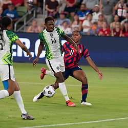 Nigeria's CHIDINMA OKEKE (14) and USA's CATARINA MACARIO (11) battle for the ball  as the US Women's National Team (USWNT) beats Nigeria, 2-0 in the inaugural match of Austin's new Q2 Stadium. The U.S. women's team, an Olympic favorite, is wrapping up a series of summer matches to prep for the Tokyo Games.