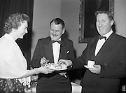 20/2/1959<br /> 02/20/1959<br /> 20 February 1959<br /> <br /> Mr Donal O'Morain of Gael Linn speaking with an unamed man and woman at the Cunmann Gaelach Inaugural