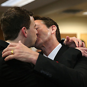 Partners Kevin Foster (right) and Joey Thibodeaux  kiss each other during their same sex wedding ceremony, just after midnight, when Florida's ban on same-sex marriage ended, at the Osceola County Courthouse in Kissimmee, Florida on Tuesday, January 6, 2014.  (AP Photo/Alex Menendez)