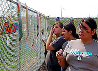 USA, Chicago, August 25, 2009.  Fans of LVEJO's efforts judge environmentally-themed skateboard design, seen outside the fenced-off Celotex site, possible home for much-needed open space. The Little Village Environmental Justice Organization, headquartered in a predominantly Mexican-American neighborhood of Chicago, campaigns not only against pollution but for clean power, park facilities, urban agriculture, and restoring public transit. LVEJO's staff and volunteers make significant outreach and education efforts, especially for youth. Photo for an HOY feature story by Jay Dunn.
