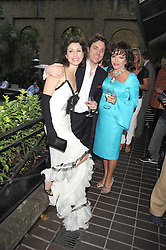 Left to right, SACHA & ANGELA NEWLEY and JOAN COLLINS  at a private view of work by Sacha Newley entitled 'Blessed Curse' in association with the Catto Gallery held at the Arts Club, Dover Street, London W1 on 2nd July 2008.<br /><br />NON EXCLUSIVE - WORLD RIGHTS