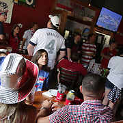 Patrons watch USA v Portugal match of the 2014 World Cup Sunday June 22, 2014 at Courts and Sports in Wilmington, N.C. The bar serves as the home of The American Outlaws, the official supporters of the U.S. Men's National Soccer team. (Jason A. Frizzelle)