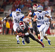 Kentucky Wildcats defensive end Farrington Huguenim (91) and linebacker Kory Brown (34) pursue Arkansas Razorbacks runningback Dennis Johnson (33) during the first half of a game at Donald W. Reynolds Razorback Stadium in Fayetteville, Ark., on Oct.. 13, 2012. Photo by Beth Hall