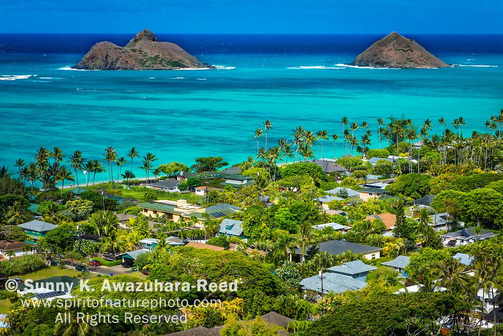 Overlook of Mokulua Islands and Lanikai residential neighborhood, viewed from Lanikai Pillbox, Kailua, Oahu, Hawaii.