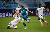 SAINT-PETERSBURG, RUSSIA - OCTOBER 20: Sardar Azmoun of Zenit St Petersburg is tackled by Brandon Mechele of Club Brugge KV during the UEFA Champions League Group F match between Zenit St Petersburg and Club Brugge KV at Gazprom Arena on October 20, 2020 in Saint-Petersburg, Russia [Photo by MB Media]