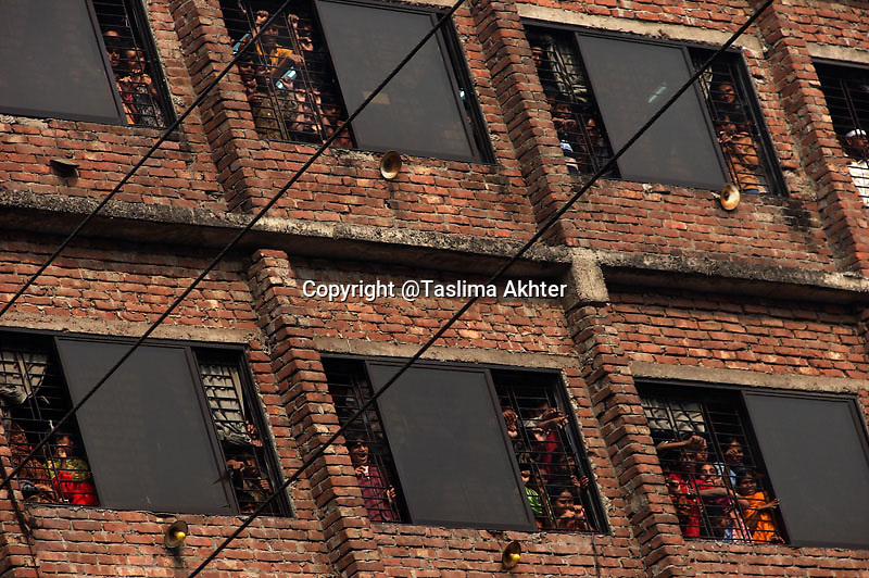 Due to workers agitation in some industries, workers of rest of the factories are locked in this way by the authorities. 15th January, 2008. Mirpur, Dhaka, Bangladesh