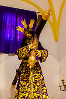 A paso (float) figure of Jesus Christ wearing a 200 year old costume, carrying the cross.  The Church and Convent of N. S. Del Carmen, Alhama de Granada,Granada Province, Andalusia, Spain.