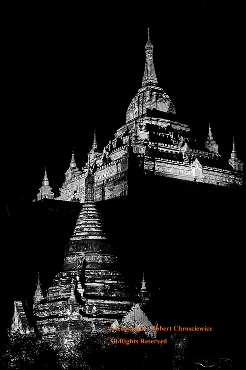 Thatbyinnyu Morning (B&W): The revered Thatbyinnyu Temple is well lit and rises majestically to dominate the early morning sky in Bagan Myanmar.